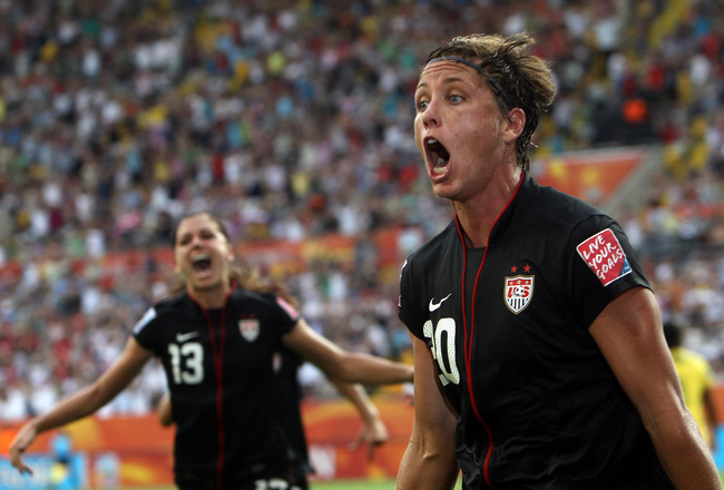 DRESDEN, GERMANY - JULY 10:  Abby Wambach of USA celebrates after scoring her team's equalizing goal during the FIFA Women's World Cup 2011 Quarter Final match between Brazil and USA at Rudolf-Harbig-Stadion on July 10, 2011 in Dresden, Germany.  (Photo b
