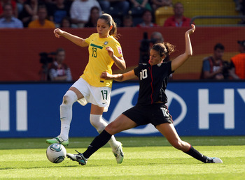 DRESDEN, GERMANY - JULY 10: Erika (L) of Brazil and Carli Lloyd (R) of USA battle for the ball during the FIFA Women's World Cup 2011 Quarter Final match between Brazil and USA at Rudolf-Harbig-Stadion on July 10, 2011 in Dresden, Germany. (Photo by Marti