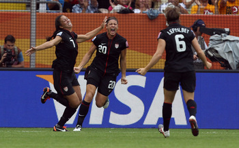 DRESDEN, GERMANY - JULY 10: Shannon Boxx (L) of USA celebrate their team opening goal during the FIFA Women's World Cup 2011 Quarter Final match between Brazil and USA at Rudolf-Harbig-Stadion on July 10, 2011 in Dresden, Germany. (Photo by Martin Rose/Ge