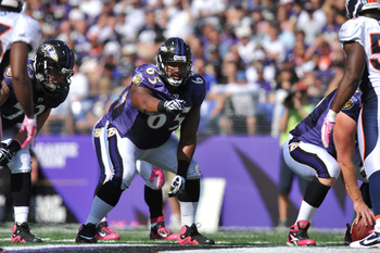 BALTIMORE, MD - OCTOBER 10: Chris Chester #65 of the Baltimore Ravens defends against the Denver Broncos at M&T Bank Stadium on October 10, 2010 in Baltimore, Maryland. Players wore pink in recognition of Breast Cancer Awareness Month. The Ravens defeated