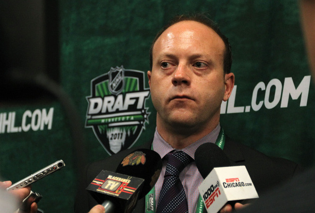 ST PAUL, MN - JUNE 25:  General manager Stan Bowman of the Chicago Blackhawks answers questions during day two of the 2011 NHL Entry Draft at Xcel Energy Center on June 25, 2011 in St Paul, Minnesota.  (Photo by Bruce Bennett/Getty Images)