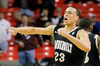 ATLANTA, GA - MARCH 11:  John Jenkins #23 of the Vanderbilt Commodores celebrates their win over the Mississippi State Bulldogs during the quarterfinals of the SEC Men's Basketball Tournament at Georgia Dome on March 11, 2011 in Atlanta, Georgia. The Comm