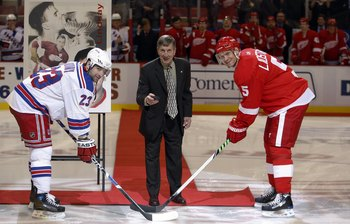 DETROIT, MI - OCTOBER 18:  Detroit Red Wings legend Ted Lindsay drops the ceremonial puck between Chris Drury #23 of the New York Rangers and Nicklas Lidstrom #5 of the Detroit Red Wings on October 18, 2008 at the Joe Louis Arena in Detroit, Michigan. The