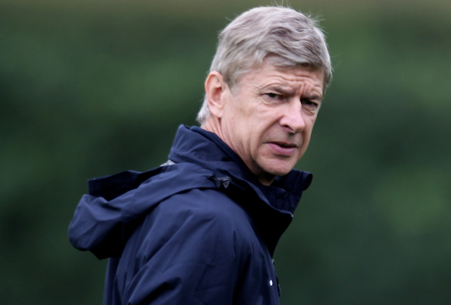 ST ALBANS, ENGLAND - SEPTEMBER 27:  Arsenal Manager Arsene Wenger looks on during a training session ahead of the UEFA Champions League game against Partizan Belgrade at the club's complex at London Colney on September 27, 2010 in St Albans, England.  (Ph