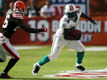 MIAMI, FL - DECEMBER 05:  Running back Rickey Williams #34 of the Miami Dolphins runs against the Cleveland Browns at Sun Life Stadium on December 5, 2010 in Miami, Florida. Cleveland defeated Miami 13-10.  (Photo by Marc Serota/Getty Images)