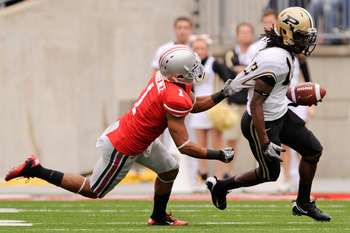COLUMBUS, OH - OCTOBER 23:  Devon Torrence #1 of the Ohio State Buckeyes hauls down Antavian Edison #13 of the Purdue Boilermakers by his shirt at Ohio Stadium on October 23, 2010 in Columbus, Ohio.  (Photo by Jamie Sabau/Getty Images)