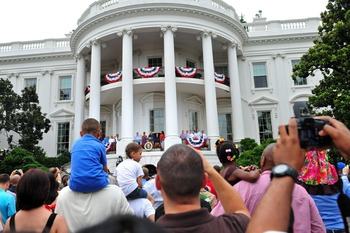 WASHINGTON, DC - JULY 4:  (AFP-OUT) U.S. President Barack Obama, joined by First Lady Michelle Obama and members of the armed services, delivers remarks at the South Lawn of the White House on July 4, 2011 in Washington, D.C. Obama hosted an Independence