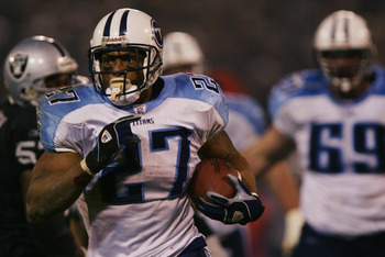 OAKLAND, CA - JANUARY 19:  Runningback Eddie George #27 of the Tennessee Titans gets loose during the AFC Championship game against the Oakland Raiders at Network Associates Coliseum on January 19, 2003 in Oakland, California.  The Raiders defeated the Ti