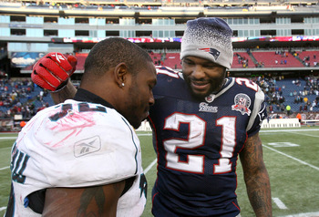 FOXBORO, MA - DECEMBER 27:  Fred Taylor #21 of the New England Patriots speaks with Maurice Jones-Drew #32 of the Jacksonville Jaguars after a Patriots' 35-7 win at Gillette Stadium on December 27, 2009 in Foxboro, Massachusetts. (Photo by Jim Rogash/Gett