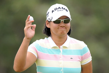 COLORADO SPRINGS, CO - JULY 08:  Yani Tseng of Chinese Taipei reacts to applause during the second round of the 2011 U.S. Women's Open at The Broadmoor on July 8, 2011 in Colorado Springs, Colorado.  (Photo by Harry How/Getty Images)