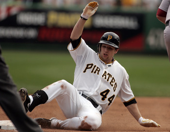 PITTSBURGH, PA - JULY 04:  Alex Presley #44 of the Pittsburgh Pirates slides into third after hitting a triple against the Houston Astros during the game on July 4, 2011 at PNC Park in Pittsburgh, Pennsylvania.  The Pirates defeated the Astros 5-2.  (Phot