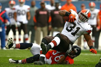 CHICAGO - NOVEMBER 01: Danieal Manning #38 of the Chicago Bears takes down Jamal Lewis #31 of the Cleveland Browns at Soldier Field on November 1, 2009 in Chicago, Illinois. The Bears defeated the Browns 30-6. (Photo by Jonathan Daniel/Getty Images)