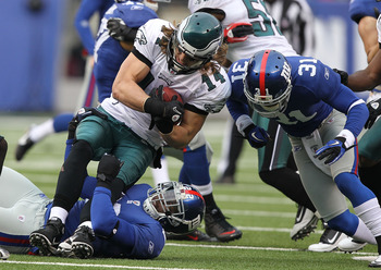 EAST RUTHERFORD, NJ - DECEMBER 19:  Aaron Ross #31 of the New York Giants tackles Riley Cooper #14 of the Philadelphia Eagles during their game on December 19, 2010 at The New Meadowlands Stadium in East Rutherford, New Jersey.  (Photo by Al Bello/Getty I