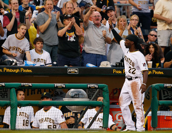 PITTSBURGH - JULY 09:  Andrew McCutchen #22 of the Pittsburgh Pirates waves to the crowd for a curtain call after being named to the NL All-Star team during the game against the Chicago Cubson July 9, 2011 at PNC Park in Pittsburgh, Pennsylvania.  (Photo