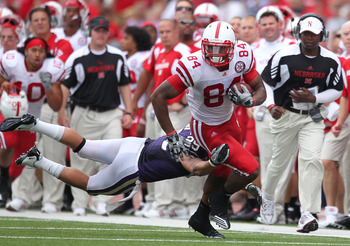 SEATTLE - SEPTEMBER 18: Wide receiver Brandon Kinnie #84 of the Nebraska Cornhuskers rushes against Nate Fellner #29 of the Washington Huskies on September 18, 2010 at Husky Stadium in Seattle, Washington. (Photo by Otto Greule Jr/Getty Images)