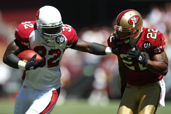 SAN FRANCISCO - SEPTEMBER 07: Edgerrin James #32 of the Arizona Cardinals runs against Nate Clements #22 of the San Francisco 49ers during an NFL game on September 7, 2008 at Monster Park in San Francisco, California.  (Photo by Jed Jacobsohn/Getty Images