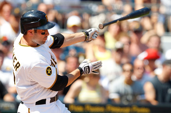 PITTSBURGH - JULY 10:  Neil Walker #18 of the Pittsburgh Pirates loses his bat while swinging at a pitch against the Chicago Cubs during the game on July 10, 2011 at PNC Park in Pittsburgh, Pennsylvania.  (Photo by Jared Wickerham/Getty Images)
