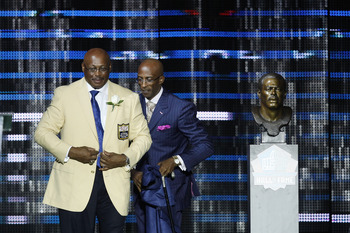 CANTON, OH - AUGUST 7: Floyd Little and his presenter, son Marc, look on during the 2010 Pro Football Hall of Fame Enshrinement Ceremony at the Pro Football Hall of Fame Field at Fawcett Stadium on August 7, 2010 in Canton, Ohio. (Photo by Joe Robbins/Get