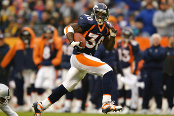 30 Dec 2001:  Running back Terrell Davis #30 of the Denver Broncos hits his stride with a 34 yard gain against the Oakland Raiders in the second quarter at Mile High Stadium in Denver, Colorado.  DIGITAL IMAGE. Mandatory Credit: Brian Bahr/Getty Images.