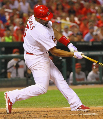 ST. LOUIS, MO - JULY 9: Albert Pujols #5 of the St. Louis Cardinals is hits a game-tying two-run home run against the Arizona Diamondbacks at Busch Stadium on July 9, 2011 in St. Louis, Missouri.  The Cardinals beat the Diamondbacks 7-6.  (Photo by Dilip