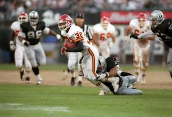8 Sep 1997:  Running back Marcus Allen #32 of the Kansas City Chiefs is tripped up while carring the football during the Chiefs 28-27 win over the Oakland Raiders at the Oakland Coliseum in Oakland, California. Mandatory Credit: Jed Jacobsohn  /Allsport