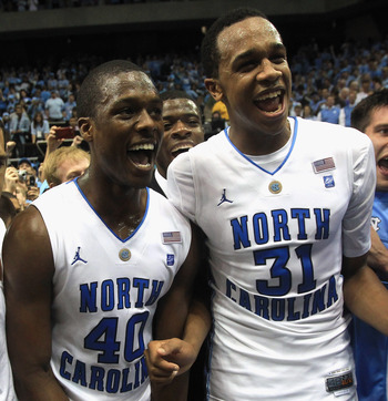 CHAPEL HILL, NC - MARCH 05:  Teammates Harrison Barnes #40 and John Henson #31 of the North Carolina Tar Heels celebrate winning the ACC Regular Season Championship as they defeated the Duke Blue Devils 81-67 at the Dean E. Smith Center on March 5, 2011 i