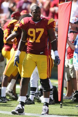 LOS ANGELES, CA - SEPTEMBER 5:  Malik Jackson #97 of the USC Trojans looks on against the San Jose State Spartans on September 5, 2009 at the Los Angeles Memorial Coliseum in Los Angeles, California.  USC won 56-3.  (Photo by Jeff Golden/Getty Images)