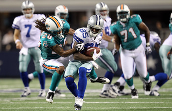 ARLINGTON, TX - SEPTEMBER 02:  Wide receiver Kevin Ogletree #85 of the Dallas Cowboys runs past Nolan Carroll #28 of the Miami Dolphins during a preseason game at Cowboys Stadium on September 2, 2010 in Arlington, Texas.  (Photo by Ronald Martinez/Getty I