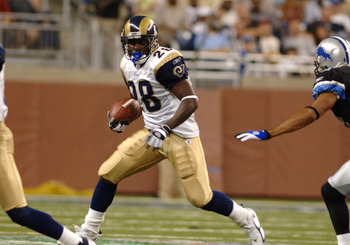 St. Louis Rams running back Marshall Faulk  rushes upfield   against  the Detroit Lions in a pre-season game on August 29, 2005 at Ford Field, in Detroit, Michigan.  (Photo by Al Messerschmidt/Getty Images)
