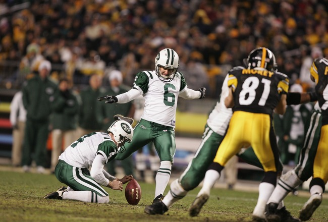 PITTSBURGH - DECEMBER 12:  Kicker Doug Brien #6 of the New York Jets attempts to score off a hold by punter Toby Gowin #4 during the game against the Pittsburgh Steelers on December 12, 2004 at Heinz Field in Pittsburgh, Pennsylvania. The Steelers won 17-