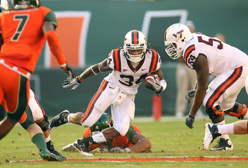 MIAMI - NOVEMBER 20:  Ryan Williams #34 of the Virginia Tech Hokies runs for a first down during a game against the Miami Hurricanes at Sun Life Stadium on November 20, 2010 in Miami, Florida.  (Photo by Mike Ehrmann/Getty Images)