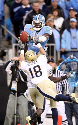 CHARLOTTE, NC - DECEMBER 26:  Jarred Holley #18 of the Pittsburgh Panthers watches as Greg Little #8 of the North Carolina Tar Heels catches a touchdown during their game on December 26, 2009 in Charlotte, North Carolina.  (Photo by Streeter Lecka/Getty I