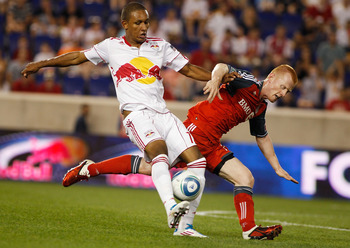 HARRISON, NJ - JULY 06:  Juan Agudelo #17 of the New York Red Bulls challenges Richard Eckersley #27 of the Toronto FC for the ball on July 6, 2011 at Red Bull Arena in Harrison, New Jersey. Red Bulls defeated Toronto FC 5-0.  (Photo by Mike Stobe/Getty I