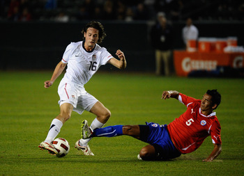 CARSON, CA - JANUARY 22: Sebastian Toro #5 of Chile tackles Mixx Diskerud #16 of the United States during the friendly soccer match at The Home Depot Center on January 22, 2011 in Carson, California. (Photo by Kevork Djansezian/Getty Images)