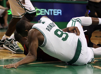 BOSTON, MA - MAY 07: Rajon Rondo #9 of the Boston Celtics injures his arm as he lands on the court after a scramble with Dwyane Wade #3 of the Miami Heat in Game Three of the Eastern Conference Semifinals in the 2011 NBA Playoffs on May 7, 2011 at the TD