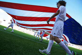 VANCOUVER, CANADA - JULY 6:  A young soccer player helps carry the USA flag onto the field during the match between the Columbus Crew and the Vancouver Whitecaps FC July 6, 2011 at Empire Field in Vancouver, British Columbia, Canada. (Photo by Jeff Vinnic
