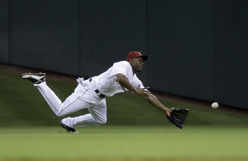 HOUSTON - JUNE 25:  Center fielder Michael Bourn #21 of the Houston Astros dives but can't make the catch off a line drive by Matt Joyce of the Tampa Bay Rays in the fifth inning at Minute Maid Park on June 25, 2011 in Houston, Texas.  (Photo by Bob Levey