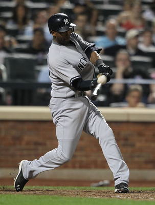 NEW YORK, NY - JULY 01: Eduardo Nunez #26  of the New York Yankees hits a single against the New York Mets at Citi Field on July 1, 2011 in the Flushing neighborhood of the Queens borough of New York City.  (Photo by Nick Laham/Getty Images)