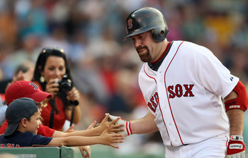 BOSTON, MA - JULY 06:  Kevin Youkilis #20 of the Boston Red Sox celebrates his solo home run in the second inning against the Toronto Blue Jays on July 6, 2011 at Fenway Park in Boston, Massachusetts.  (Photo by Elsa/Getty Images)