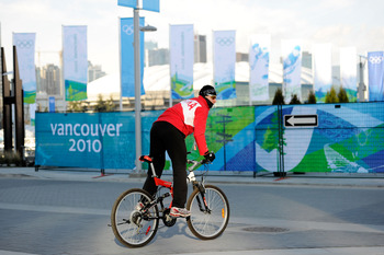 VANCOUVER, BC - FEBRUARY 09:  A Polish athlete rides a bike outside the athlete's village ahead of the Vancouver 2010 Winter Olympics on February 9, 2010 in Vancouver, Canada.  (Photo by Kevork Djansezian/Getty Images)
