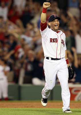 BOSTON, MA - JULY 05:  Marco Scutaro #10 of the Boston Red Sox celebrates the win over the Toronto Blue Jays on July 5, 2011 at Fenway Park in Boston, Massachusetts. The Boston Red Sox defeated the Toronto Blue Jays 3-2.  (Photo by Elsa/Getty Images)