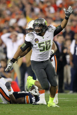 GLENDALE, AZ - JANUARY 10:  Kenny Rowe #58 of the Oregon Ducks reacts during their game against the Auburn Tigers during the Tostitos BCS National Championship Game at University of Phoenix Stadium on January 10, 2011 in Glendale, Arizona.  (Photo by Jona