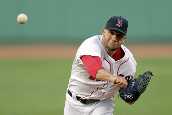 BOSTON, MA  - JUNE 21:  Alfredo Aceves #91 of the Boston Red Sox pitches against the San Diego Padres at Fenway Park on June 21, 2011 in Boston, Massachusetts.  (Photo by Jim Rogash/Getty Images)