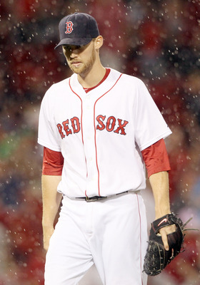 BOSTON, MA - JULY 06:  Daniel Bard #51 of the Boston Red Sox heads in during a rain delay in the eighth inning against the Toronto Blue Jays on July 6, 2011 at Fenway Park in Boston, Massachusetts.  (Photo by Elsa/Getty Images)