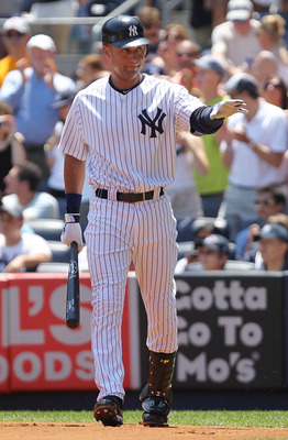 NEW YORK, NY - JULY 10:  Derek Jeter #2 of the New York Yankees acknowledges the crowd in the first inning against the Tampa Bay Rays at Yankee Stadium on July 10, 2011 in the Bronx borough of New York City.  (Photo by Nick Laham/Getty Images)