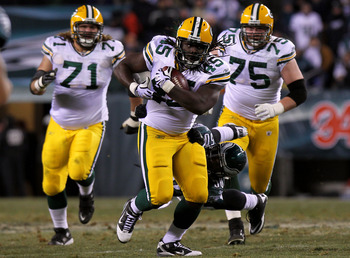 PHILADELPHIA, PA - JANUARY 09:  Quinn Johnson #45 of the Green Bay Packers tries to avoid the tackle of Ernie Sims #50 of the Philadelphia Eagles during the 2011 NFC wild card playoff game at Lincoln Financial Field on January 9, 2011 in Philadelphia, Pen