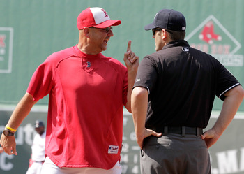 BOSTON, MA  - JULY 4:  Manager Terry Francona of the Boston Red Sox reacts to a call at first made by umpire Brian Knight during a game against the Toronto Blue Jays at Fenway Park on July 4, 2011 in Boston, Massachusetts.  (Photo by Jim Rogash/Getty Imag