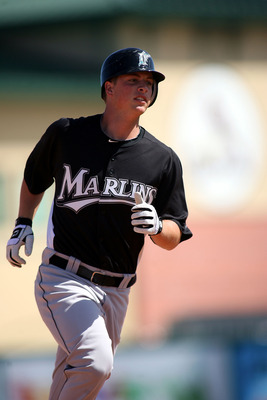JUPITER, FL - FEBRUARY 28:  Matt Dominguez #78 of the Florida Marlins hits a home run against the St. Louis Cardinals at Roger Dean Stadium on February 28, 2011 in Jupiter, Florida.  (Photo by Marc Serota/Getty Images)