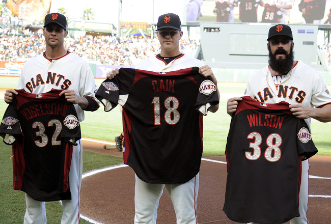 SAN FRANCISCO, CA - JULY 9: National League All-Stars Ryan Vogelsong #32, Matt Cain #18 and Brian Wilson #38 of the San Francisco Giants are presented with their Majestic All-Star jerseys before the start their MLB baseball game against the New York Mets