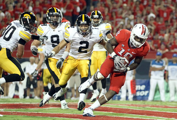 TUCSON, AZ - SEPTEMBER 18:  Wide receiver William Wright #19 of the Arizona Wildcats catches a 4 yard touchdown reception past Greg Castillo #2 of the Iowa Hawkeyes during the fourth quarter of the college football game at Arizona Stadium on September 18,